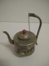 Металлический чайник с ручкой с головой дракона